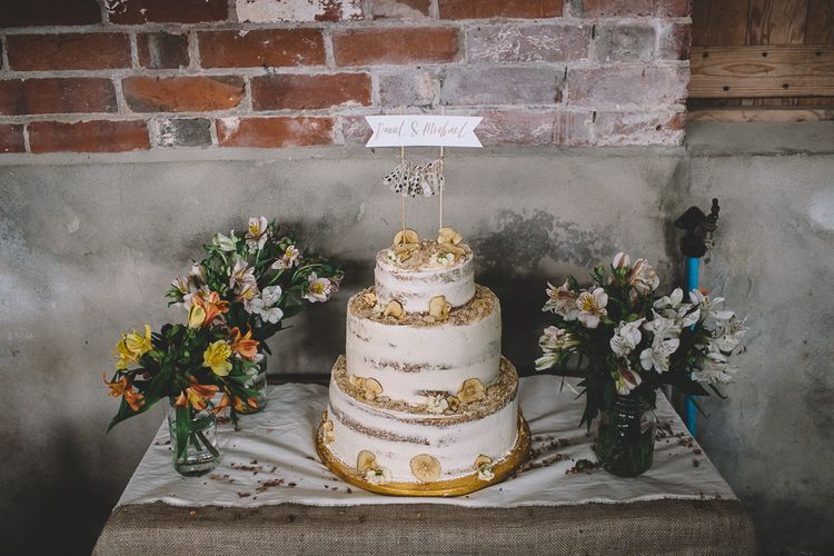 Semi Naked Wedding Cake With Dried Fruit Decor // Carrie Lavers Photography