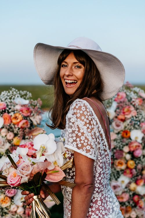 Happy Bohemian Bride in Lace Wedding Dress and Floppy Hat