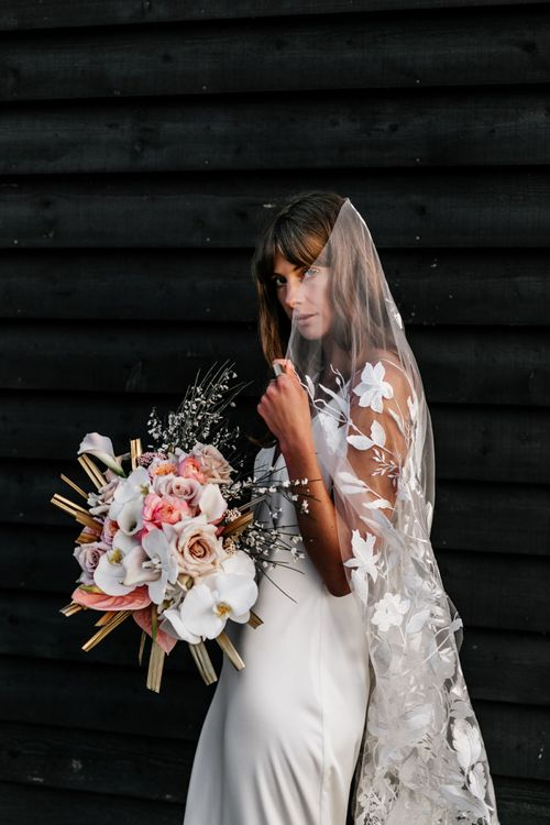Bride in Slip Wedding Dress with Lace Veil