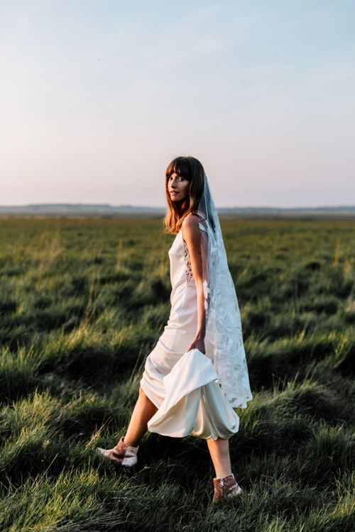 Boho Bride in Slip Wedding Dress, Lace Veil and Pink Suede Boots