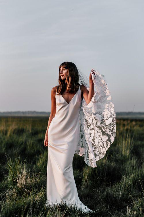 Bride in Slip Wedding Dress with Embroidered Wedding Veil