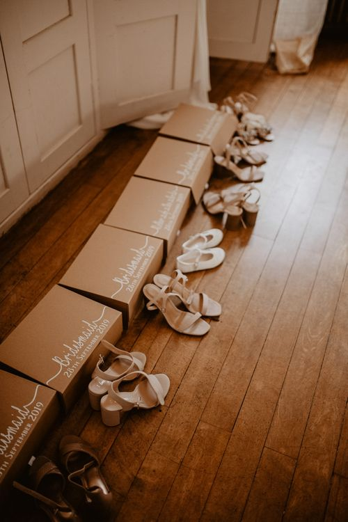 Bridesmaid gift boxes and shoes on wedding morning