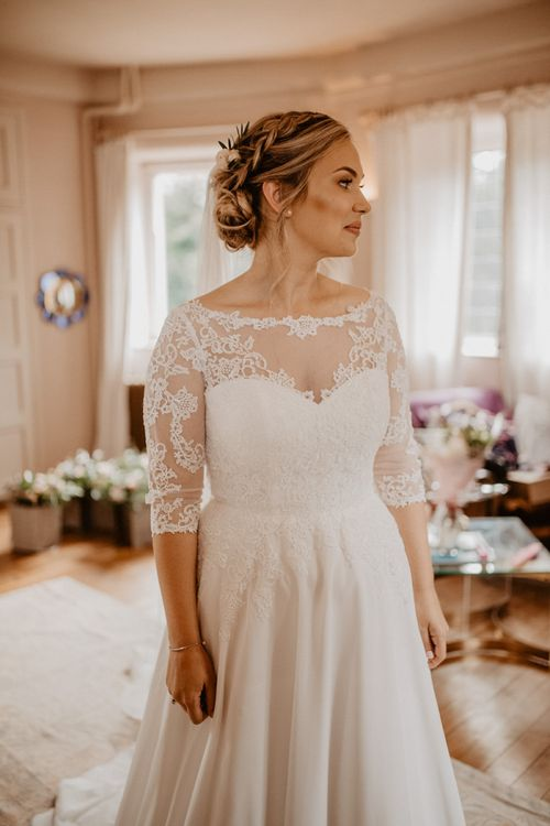 Bride in lace slash neck wedding dress with 3/4 sleeves