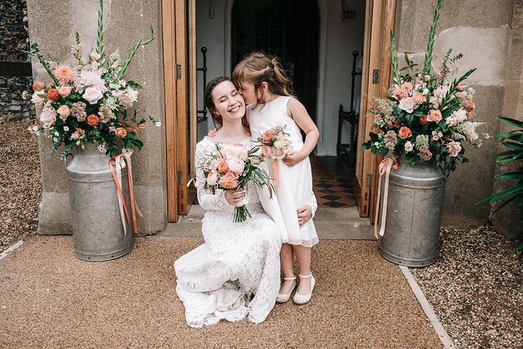 Flower Girl | Bride in Lace Wedding Dress | Peach Wedding at Swanton Morley House and Gardens in Norfolk |  Jason Mark Harris Photography | Together we Roam Films