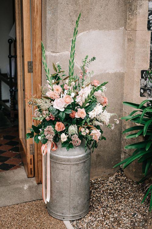 Milk Churn Wedding Floral Arrangement | Peach Wedding at Swanton Morley House and Gardens in Norfolk |  Jason Mark Harris Photography | Together we Roam Films