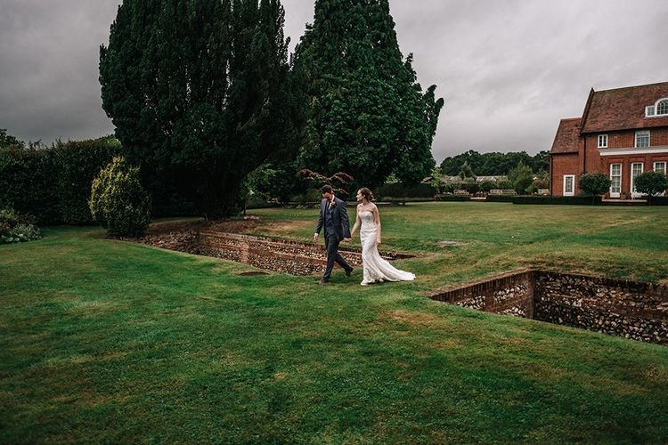 Bride in Lace Wedding Dress | Groom in Next Suit | Peach Wedding at Swanton Morley House and Gardens in Norfolk |  Jason Mark Harris Photography | Together we Roam Films