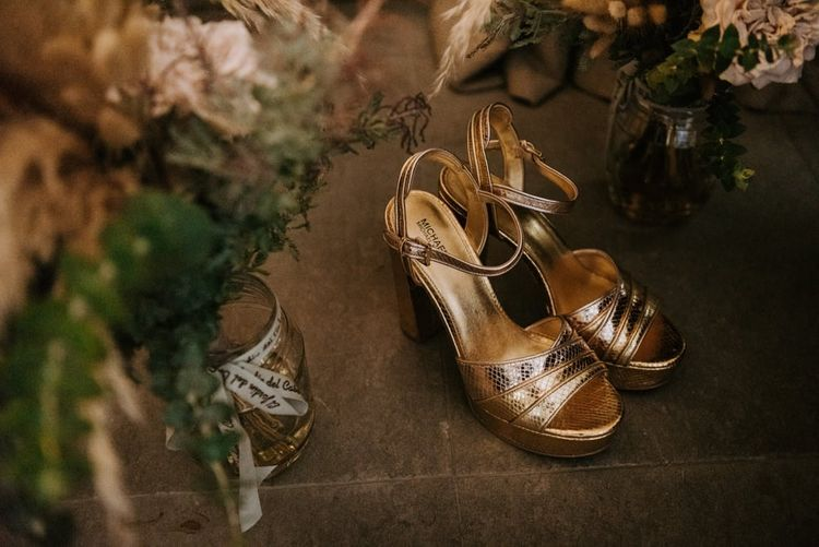 Gold wedding shoes with Made With Love Bridal Dress