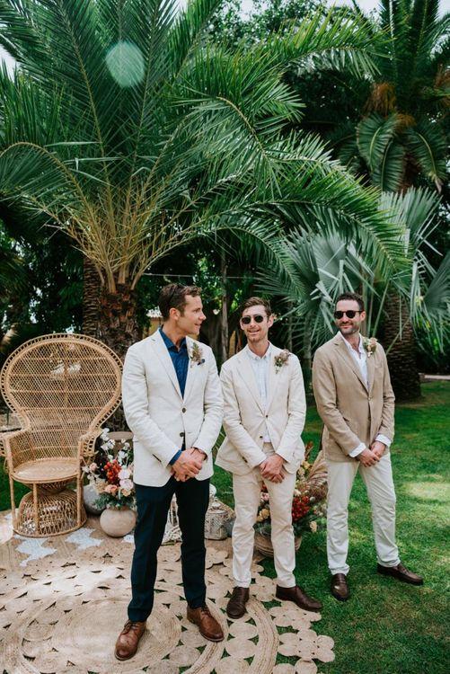 Groom in cream wedding suit for destination wedding