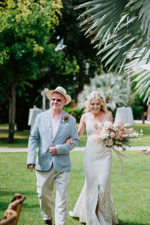 Bride walks down the aisle in Made With Love Bridal dress