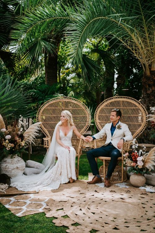 Bride in Made With Love Bridal dress and groom during outdoors wedding ceremony