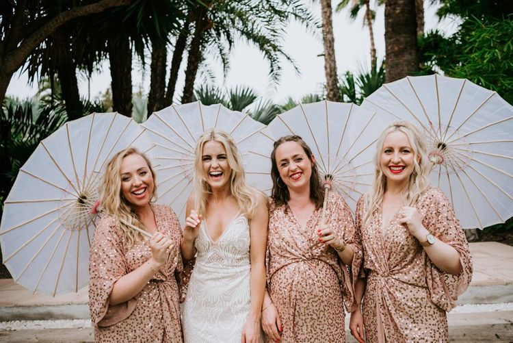 Bride in Made With Love Bridal dress  with bridesmaids in sequin dresses