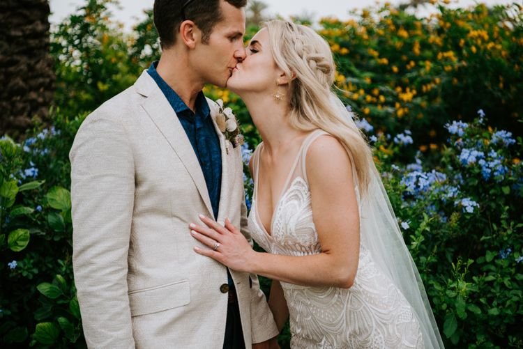 Bride in Made With Love Bridal dress kisses groom at Spanish wedding