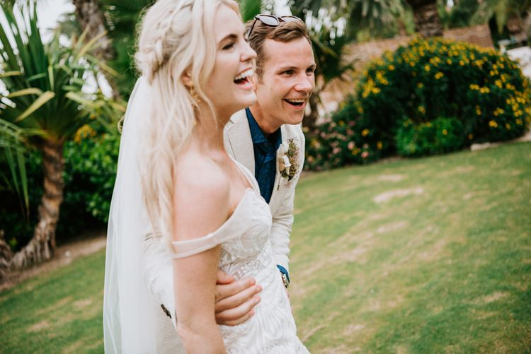 Bride with braided hair in Made With Love Bridal dress