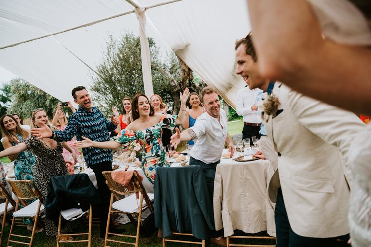 Guests welcome bride and groom to wedding breakfast