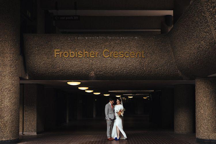 Bride in Charlie Brear Wedding Dress and Groom in Light Grey Suit with Orange Tie