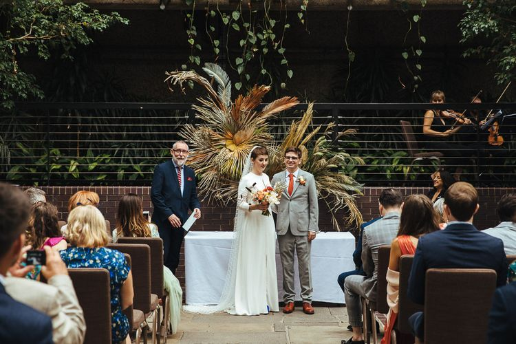 Wedding Ceremony with Bride in Charlie Brear Dress and Groom in Grey Suit