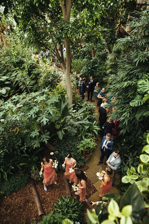 Wedding Guests Standing Barbican Conservatory in London