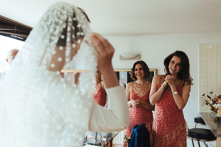 Wedding Morning Bridesmaids in Polka Dot Orange Bridesmaid Dresses First Look
