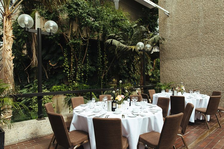 Wedding Reception at Barbican Conservatory in London with Minimalist Floral Centrepiece
