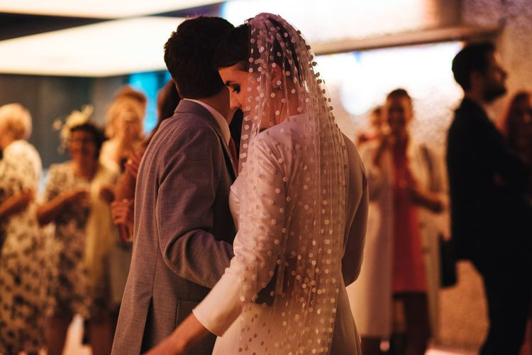 First Dance with Bride in Minimalist Wedding Dress and Polka Dot Veil