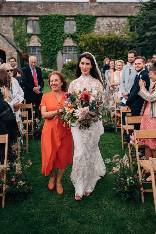 Outdoor Wedding Ceremony Bridal Entrance in Lace Catherine Deane Bridal Gown Escort by The Mother  of The Bride