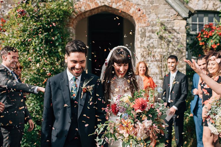 Confetti Exit with Bride in Catherine Deane Wedding Dress and Groom in Paul Smith Suit and Liberty Print Tie