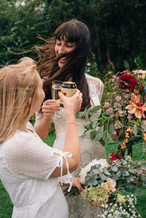 Bride in Catherine Deane Wedding Dress Enjoying Champagne at the Drinks Reception