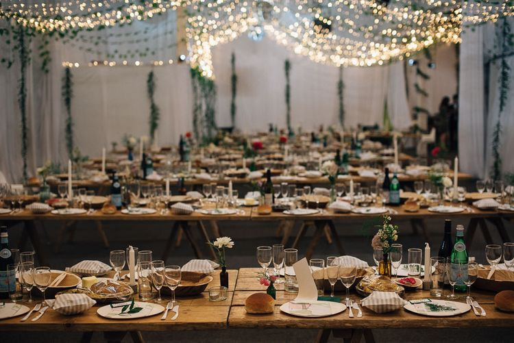 Rustic Wedding Reception with Trestle Tables and Fairy Lights Decor