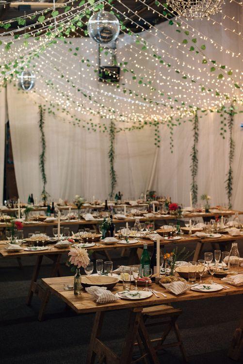 Rustic Wedding Reception with Trailing Fairy Lights Decor and Foliage Wedding Decor
