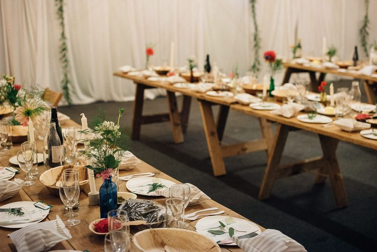 Trestle Tables with Flowers Stems in Vases and Candles