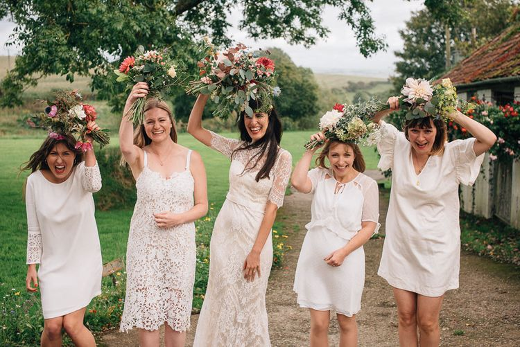 Bridal Party with Bride in Lace Catherine Deane Wedding Dress and Bridesmaids in Different White Dresses
