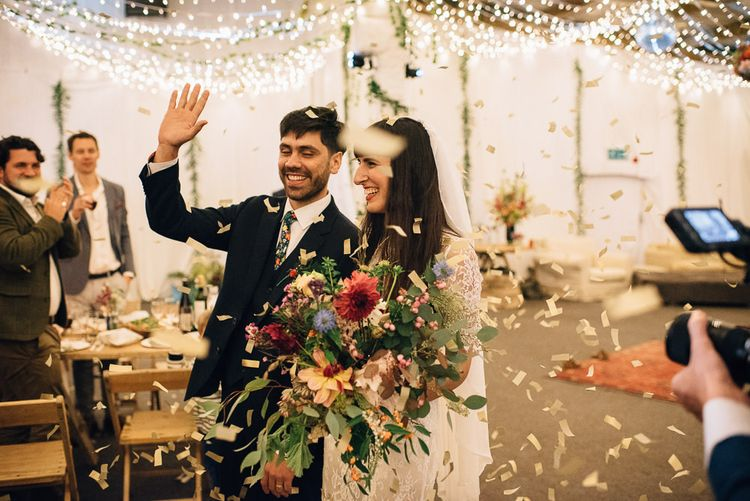 Wedding Reception Entrance with Bride in Catherine Deane Wedding Dress and Groom in Paul Smith Suit