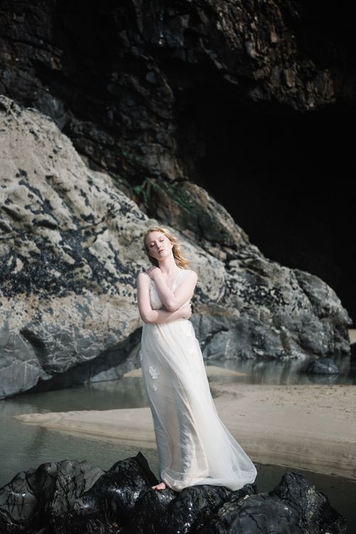 Bride in This Modern Love Bridal Lace Wedding Dress | Romantic Runaway Bride Wedding Inspiration at Chapel Porth beach in Cornwall, Styled by Boelle Events | Olivia Bossert Photography