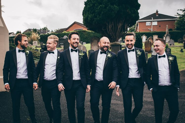 Groom and Groomsmen in Black Tie Suits from Moss Bros. with Bow Tie | Nautical Wedding on SS Nomadic Boat in Belfast with Black Tie Dress Code | Sarah Gray Photography