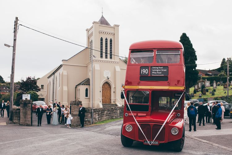 Vintage Red Routemaster Bus Decorated with White Ribbon | Gilnahirk Presbyterian Church | Nautical Wedding on SS Nomadic Boat in Belfast with Black Tie Dress Code | Sarah Gray Photography