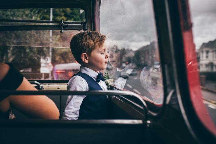 Page Boy in Navy Suit and Bow Tie | Vintage Red Routemaster Bus for Wedding Party | Nautical Wedding on SS Nomadic Boat in Belfast with Black Tie Dress Code | Sarah Gray Photography