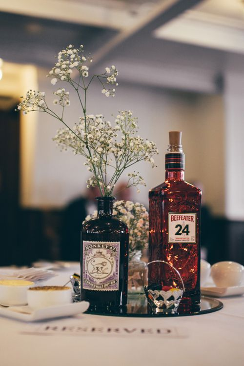 Gin Bottle Décor | Gypsophila Centrepieces | Nautical Wedding on SS Nomadic Boat in Belfast with Black Tie Dress Code | Sarah Gray Photography