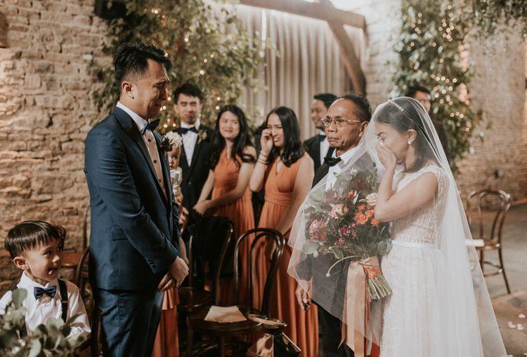 Emotional wedding ceremony bridal entrance at Cripps Barn