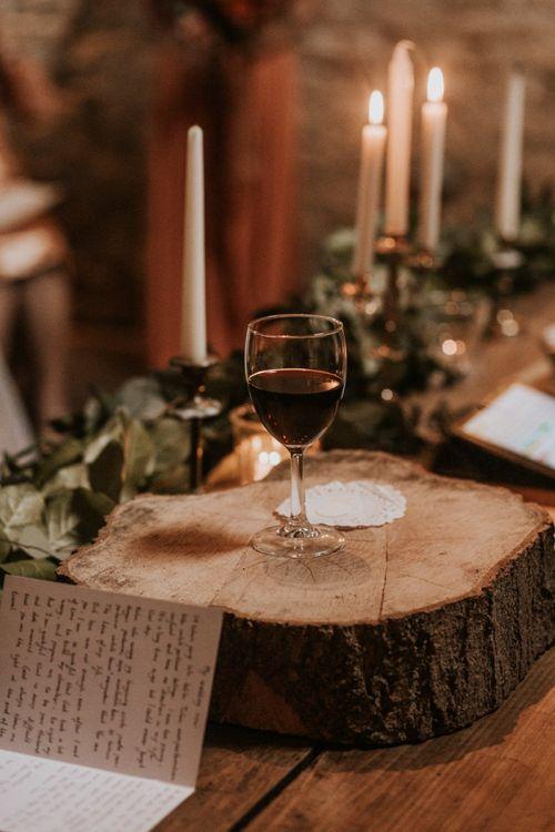 Mulled wine on tree stump at Autumn wedding