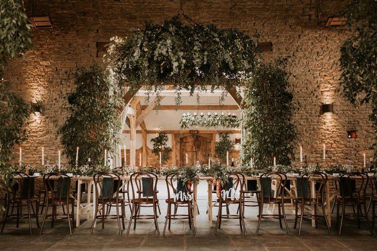 Intimate wedding reception at Cripps Barn with foliage wedding decor