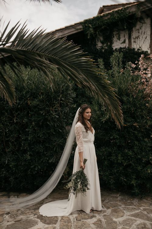 Bride in Donatelle Godart Wedding Dress  with Lace Long Sleeves