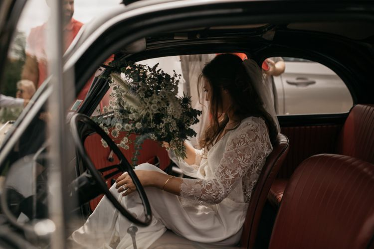 Bride in Donatelle Godart Wedding Dress Getting into Black Fiat 500 Wedding Car