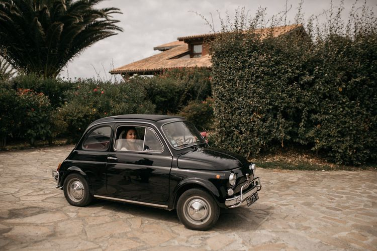 Bride in Donatelle Godart Wedding Dress inside Black Fiat 500 Wedding Car