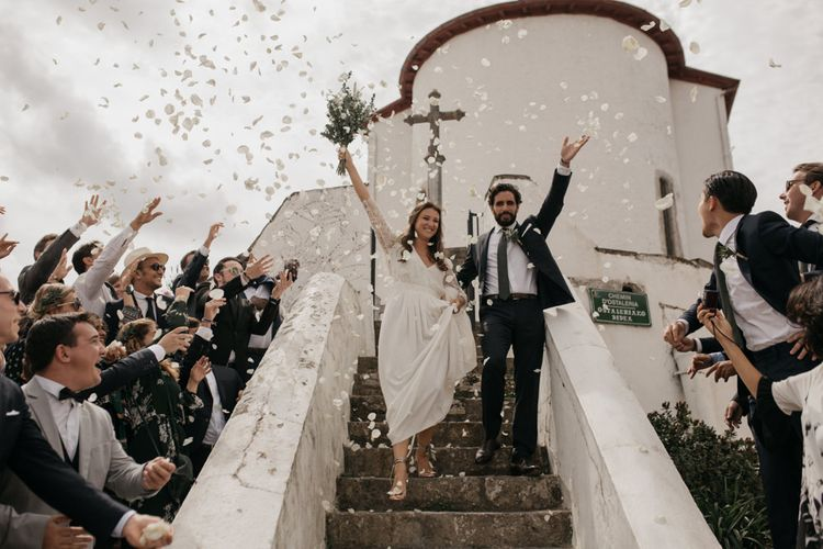 Confetti Moment with Bride in Donatelle Godart Wedding Dress & Groom in De Fursac Suit