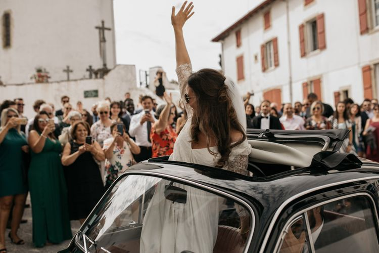 Bride in Donatelle Godart Wedding Dress Waving out of a Fiat 500 Sun Roof