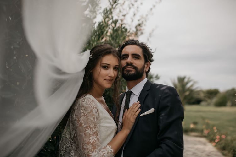 Bride in Donatelle Godart Wedding Dress & Veil with Bearded Groom in De Fursac Suit