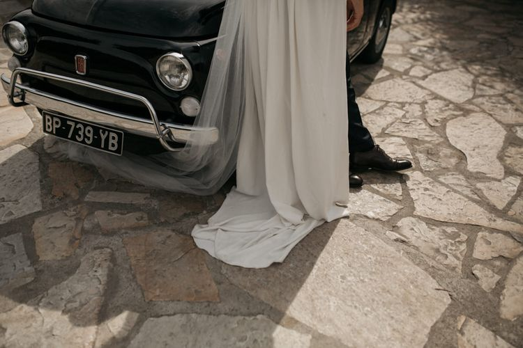 Bride in Donatelle Godart Wedding Dress Standing Next to a Fiat 500 Wedding Car
