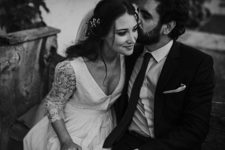 Bride in Donatelle Godart Wedding Dress & Groom in De Fursac Suit Embracing