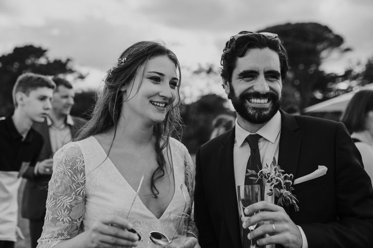 Bride in Donatelle Godart Wedding Dress & Groom in De Fursac Suit  Smiling