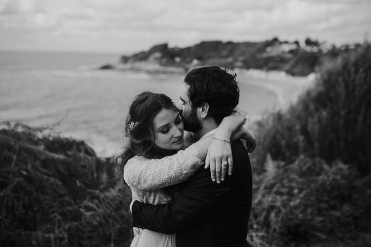 Coastal Portrait of Bride in Donatelle Godart Wedding Dress & Groom in De Fursac Suit